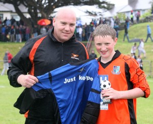 Mark Greaney receiving the U.14 Goalkeeping of the Tournament at the Salthill national 5's